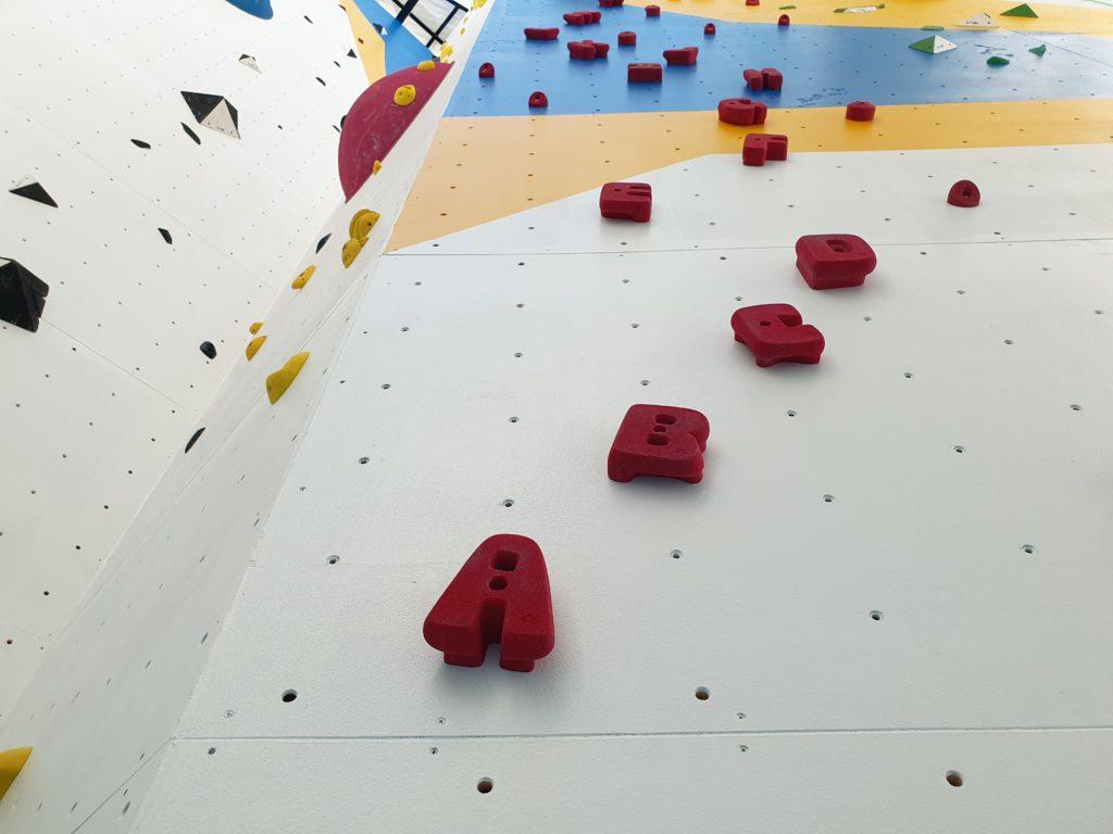 alphabet holds rock wall