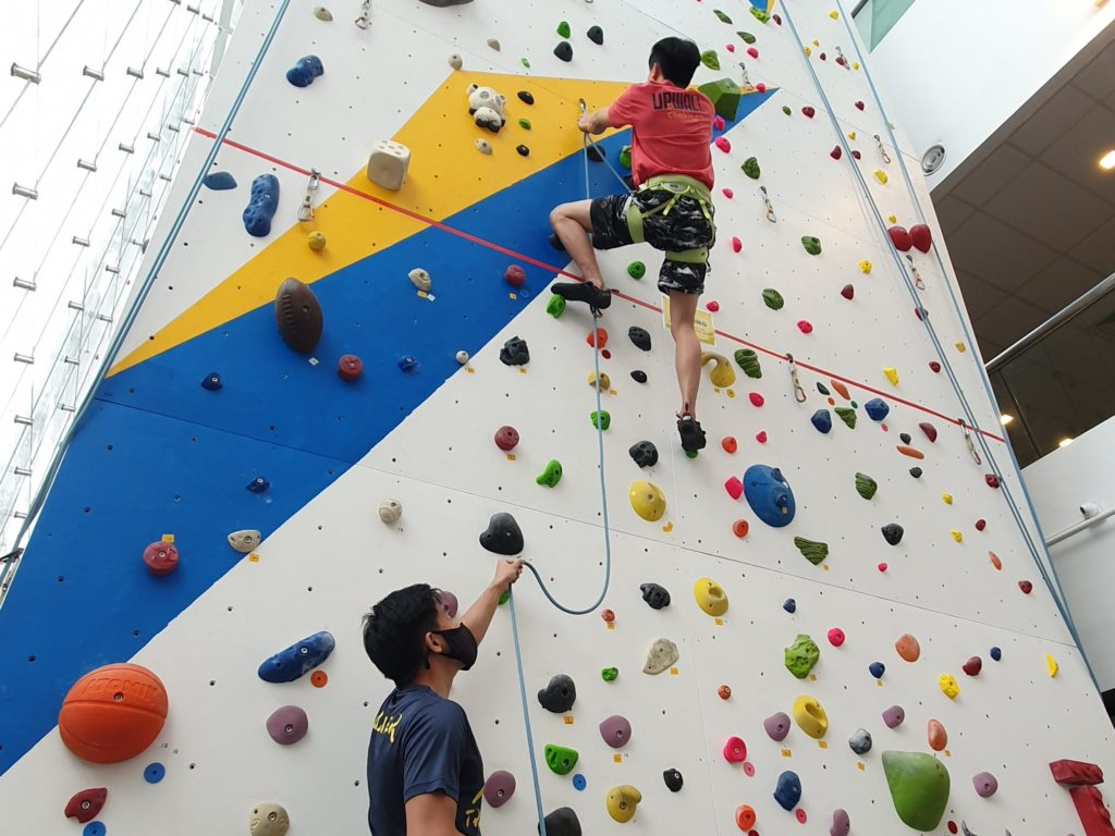 lead climbing and belaying